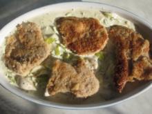 Überbackene Schnitzel in Sahne-Lauchsoße - Rezept