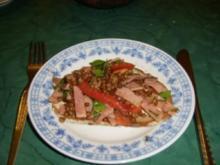 Linsensalat mit Tomaten und Schinken - Rezept