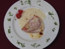 Mit Fetakäse gefüllte, original eingelegte Florina-Paprika an einer Sahnesoße - Rezept