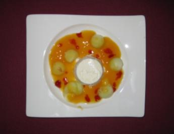 Limoncellocreme und Melonenkugeln in Kräuterlikör-Orangengelee - Rezept