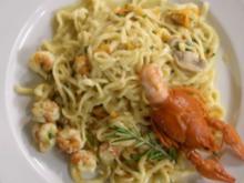 Tagliolini mit Flusskrebsfleisch in scharfer Curry-Chilisoße an Gemüsejulienne - Rezept
