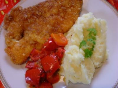 Paprika-Putenschnitzel mit knuspriger Chips-Panade - Rezept