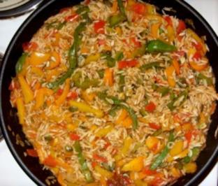 Putenschnitzel natur mit feurigem Gemüsereis - Rezept