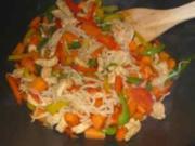 Gebratenes Schweinefleisch und Paprika im WOK oder Pfanne - Rezept