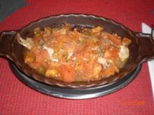 Fischfilet gebacken mit Tomaten...(griechisch) - Rezept