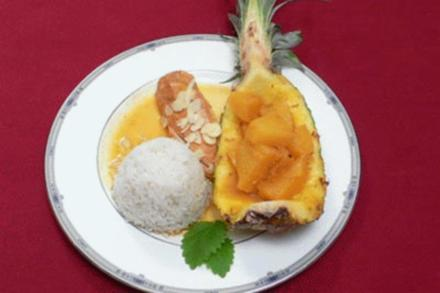 Mexikanisches Hähnchenfilet mit Orangensoße und Ananas an Reis - Rezept