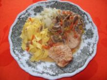 Putenschnitzelchen mit Champignon-Sahnesoße - Rezept