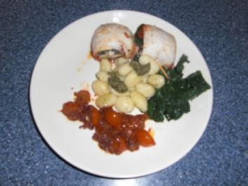 Pangasius- Spinatröllchen mit Tomaten - Rezept