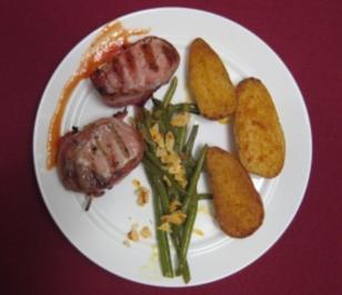 Schweinelende in Speck gewickelt mit Knoblauch-Parmesan-Kartoffeln - Rezept