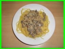 Champignon-Sahnesosse auf Spaghettinest - Rezept