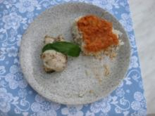 Pangasiusfiletröllchen mit Tomatensauce und Bärlauch - Rezept