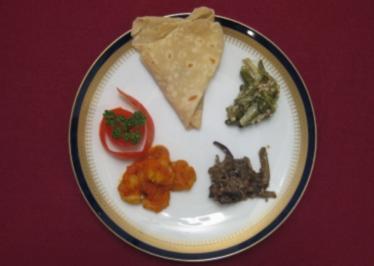 Scampi in pikanter Tomatensoße mit Farata und Gemüse - Rougaille Camaron - Rezept