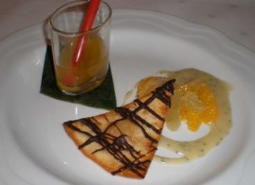 Orangen-Limettensalat mit Schokoladenchips auf weißer Schokoladensoße - Rezept
