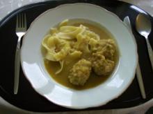 Fleischklößchen in Currysauce - Rezept