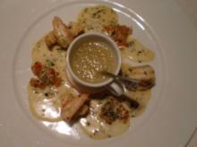 Scampi in Café de Paris-Butter mit Senffrüchten an Calvadossorbet - Rezept