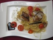 Seeteufelfilets mit Vanillebutter auf Spaghettini mit Orangen-Tomaten - Rezept