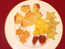 Tete-de-Moine-Rosetten auf Blätterteig an Sterntalern - Rezept