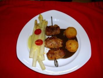 Schweinefiletröllchen gefüllt mit Senf-Tomantenmark und blanchierten Lauch an Balsamicojus - Rezept