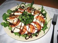 Tomate & Mozarella auf Rucolabeet - Rezept