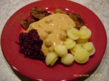 Kartoffelpilze an Minischnitzeln und Rotkraut - Rezept