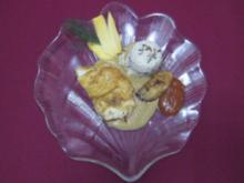 Zanderfilet in Curryrahm mit Wildreis, Mangoscheiben und Gartenkräutern - Rezept