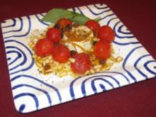 Ziegenfrischkäse mit gebratenen Tomaten an Orangensoße - Rezept