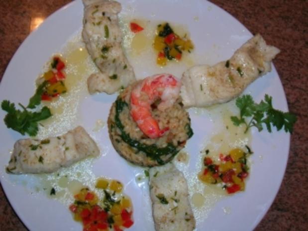 Steinbeißerfilet auf Spinatrisotto mit Pinienkernen und Paprikabutter - Rezept