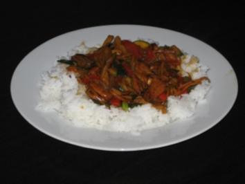 Hühnchenfleisch mit Gemüse und Reis - Rezept