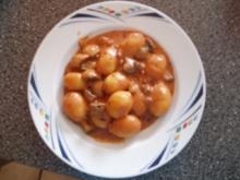 Gnocchi mit Tomaten-Rahm-Champignons - Rezept