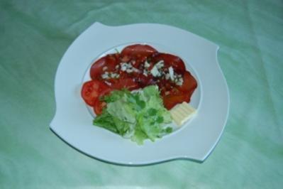 Bresaola mit Tomatenvinaigrette und frischem Parmesan - Rezept