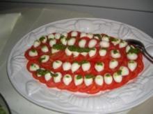 Gäste-Tomaten mit Mozarellakugeln - Rezept