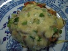 Rinderhacksteaks mit Gemüse-Käsehaube, überbacken - Rezept