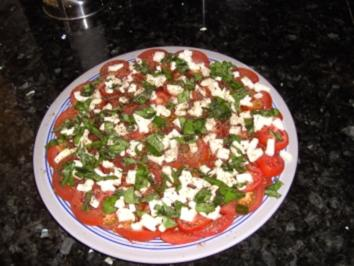 Tomaten mit Mozarella und Basilikum - Rezept