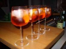 Sekt Cocktail mit Piquante-Früchten - Rezept