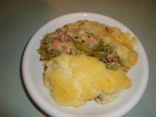 Bohnen und Schinken mit einer Decke aus Kartoffelpüree - Rezept