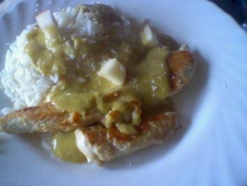 Hähnchenstreifen mit Reis und Currysoße - Rezept