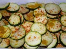 Zucchini und Auberginen,mit Garnelen und Spiegeleiern - Rezept