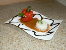 Gefüllte Paprika an Olivensauce mit Reis - Rezept