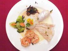 Variation von Fisch mit Reisbällchen auf asiatischem Gemüsebett - Rezept