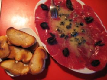 Carpaccio vom Rinderfilet mit Senf-Olivendressing - Rezept