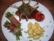 Lammkrönchen mit Kräuterfüllung, Rotweinsauce, Bohenbouquet und Rosmarin Gnocchi - Rezept
