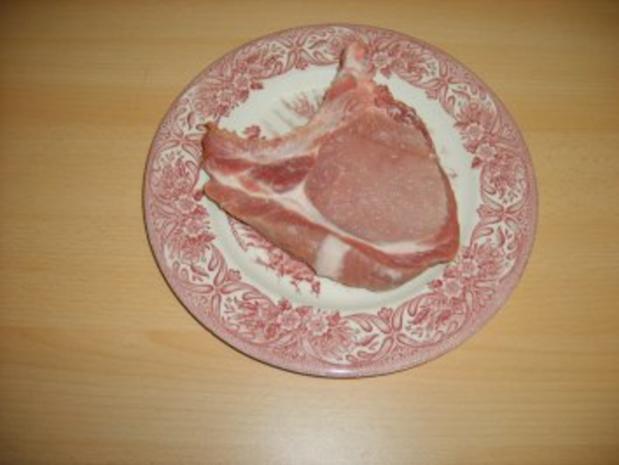 Paniertes Kotelett mit Erbsen und Möhrchen - Rezept - Bild Nr. 2