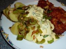 Schnitzel im Käsemantel mit Lauchgemüse auf Salzkartoffeln und Sauce Hollandaise - Rezept