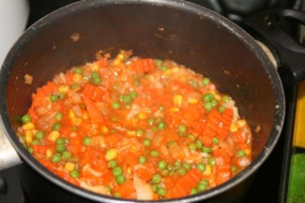 Chicken-Nuggets auf Gemüsereis - Rezept - Bild Nr. 3