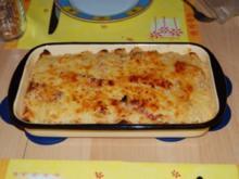 gefüllte Palatschinken mit Käse überbacken - Rezept