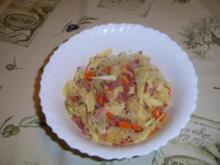 Sauerkraut-Schinkensalat mit Käsestreifen - Rezept