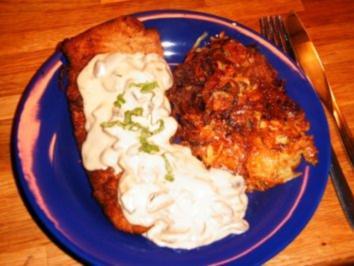 Rezept: Schweineschnitzel mit Champignon-Rahm-Soße mit Kartoffelrösti