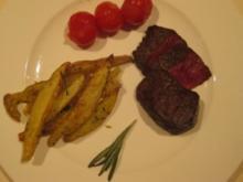 Straußenfilet mit Thymian-Rosmarinkartoffeln und Ofentomaten - Rezept