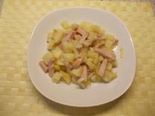 Sellerie-Apfel-Salat mit Fleischwurst - Rezept