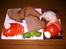 Geröstetes Bauernbrot mit Knoblauch-Tomate - Rezept